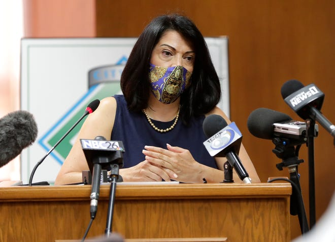 Dr. Yolo Diaz speaks in support of an indoor face-mask requirement throughout Green Bay being proposed by Mayor Eric Genrich during a press conference at City Hall on July 20, 2020, in Green Bay, Wis. City Council will vote on the mandate on July 21, 2020.