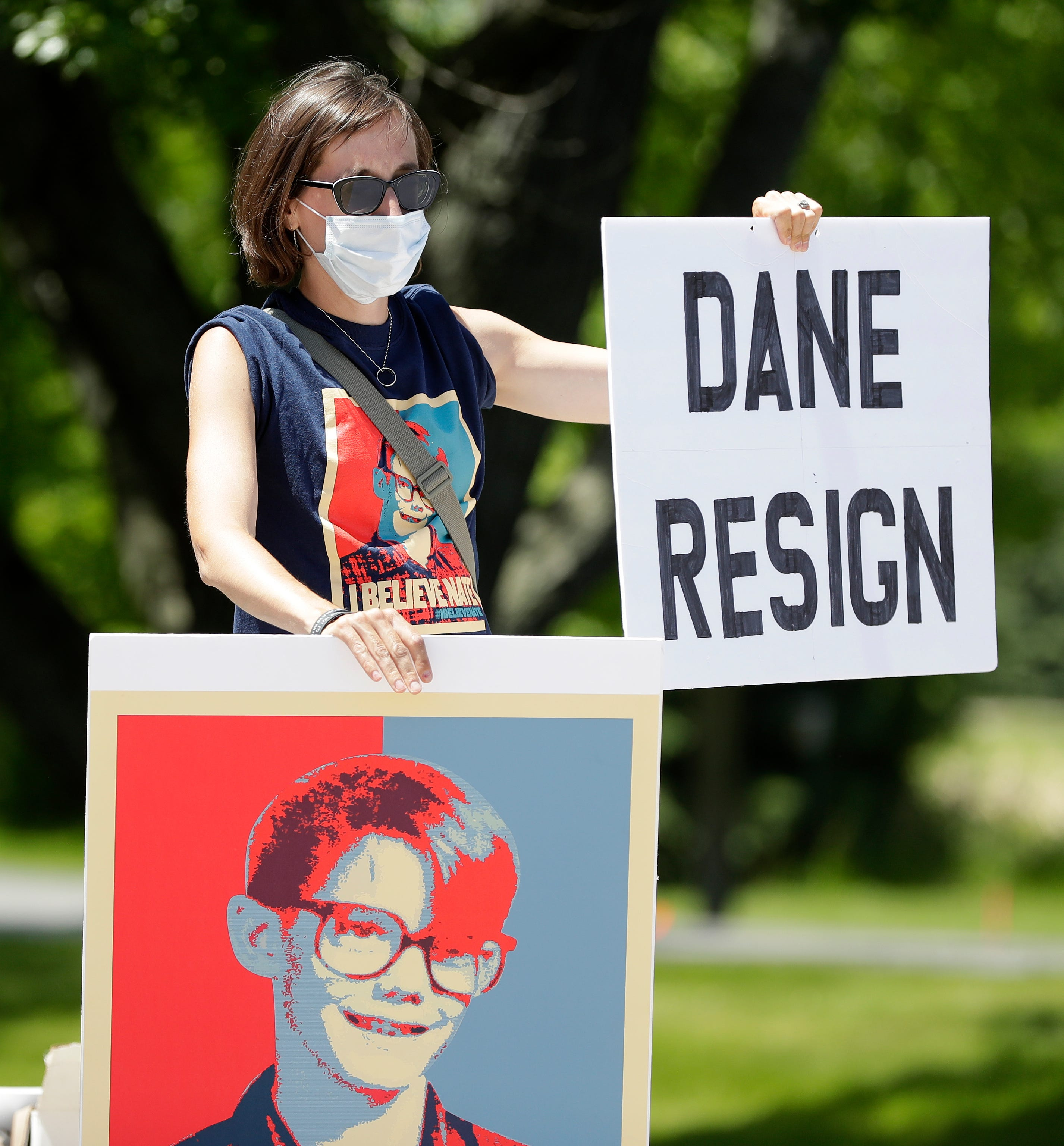 Karen Lindstrom, wife of Nate Lindstrom, protests along Webster Avenue outside St. Norbert Abbey on June 6, 2020, at the De Pere-Allouez border. Nate Lindstrom, 45, said three priests sexually abused him as a teen; he died by suicide in March 2020.
