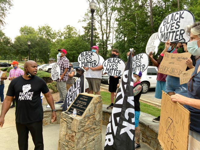 Activist Bruce Wilson speaks at a rally in Mauldin, as protests continue over a Mauldin council member, Sunday, July 19, 2020.
