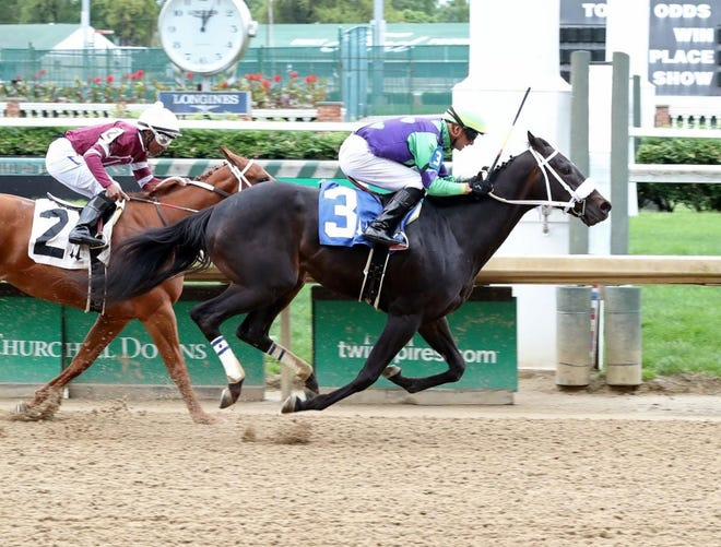 Hopeful Princess and jockey Corey Lanerie edged Mad Maddy in the first race of 2020 for 2-year-olds May 21 at Churchill Downs in Louisville.