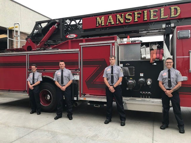 Four new firefighters were sworn in Monday to the Mansfield Fire Department. Left to right are: Mark R. Sieving, Jared Hagen, Brandon Young and Christopher Boyd. Lou Whitmire/News Journal