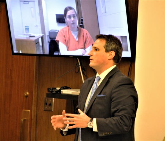 Angel R. Morgan listens as Marion County Prosecutor Ray Grogan speaks to the judge during her arraignment hearing on Monday, July 20, 2020, in Marion County Common Pleas Court. She and Shaquille S. Cochran have each been charged with two counts of murder, felonious assault, and two counts of endangering children for the death of Cochran's 3-year-old son on July 5. Morgan and Cochran are being held on $1 million bond each.