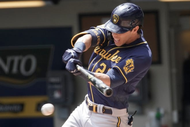 The Brewers' Christian Yelich collects his first hit of the interasquad series Monday at Miller Park.
