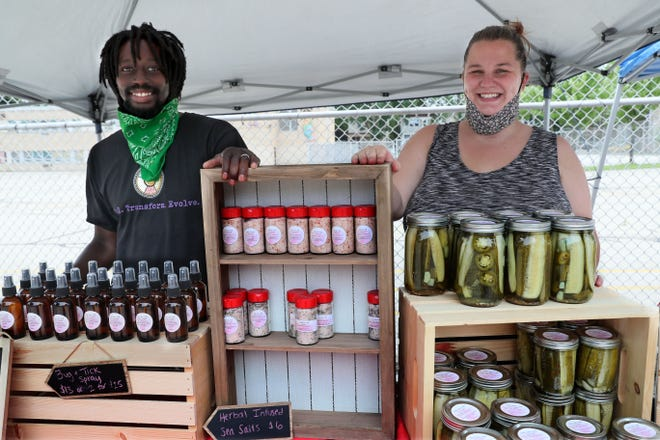 Martice Scales and his wife, Amy Kroll-Scales, sell products from the Scales Family Farm at the Riverwest Gardeners Market.