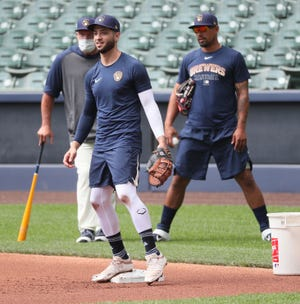 Ryan Braun runs a drill during Brewers training camp at Miller Park on July 5.