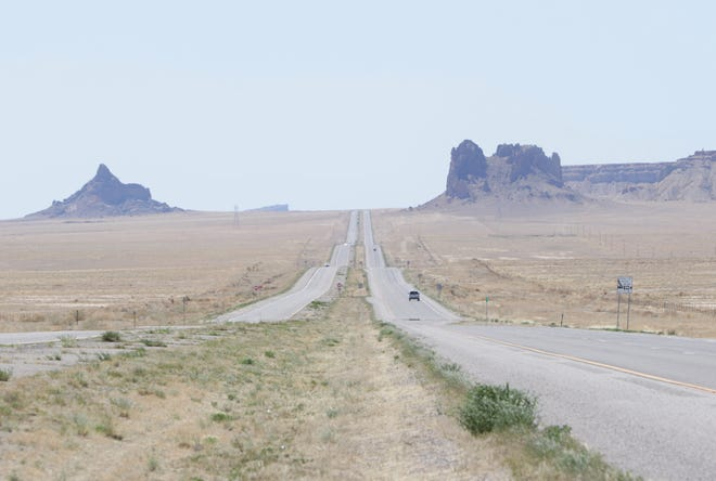 Vehicles move on U.S. Highway 491 between Shiprock and Table Mesa during a weekend lockdown on April 25, 2020.