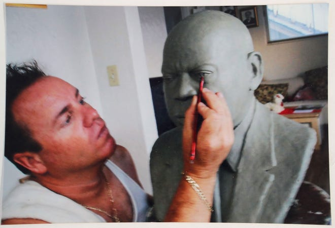 Artist Claudio D'Agostino sculpts a bust of John Lewis. He presented it to the late congressman in 2005.