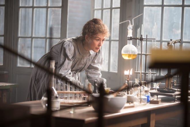 Marie Curie (Rosamund Pike) at work in the lab in a scene from 'Radioactive.'
