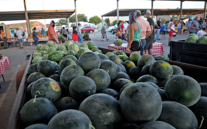 Customers and vendors gather at the Concho Valley Farmers Market in San Angelo for the 2020 Melon Fest on Saturday, July 18, 2020.