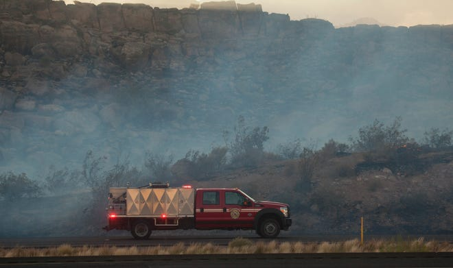 Fire crews from around Washington County fight a wildfire near Leeds Sunday, July 19, 2020.