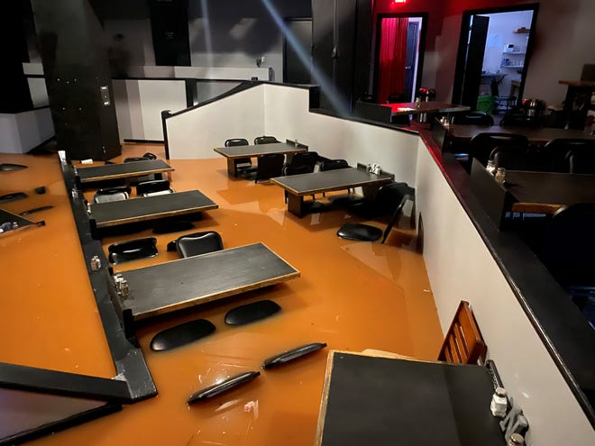 Backdoor Theatre experienced severe damage after a water main broke that tied to their fire suppression system. This photo shows water up to the seats of chairs in the dinner theater.