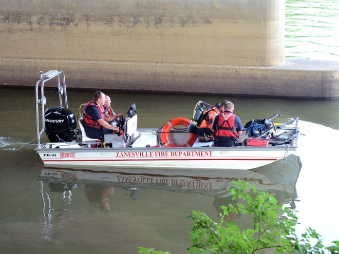 Zanesville Fire Department personnel searched for a Zanesville man Monday evening in the Muskingum River in Zanesville.