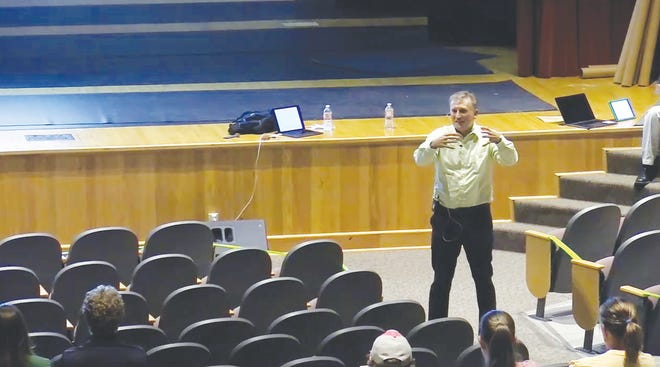 Superintendent Tony Helfrich answers questions regarding Pratt USD 382 fall school reopening dates in the Liberty Middle School Auditorium. A Zoom option was available for those unable to attend or who felt safer in an online format.