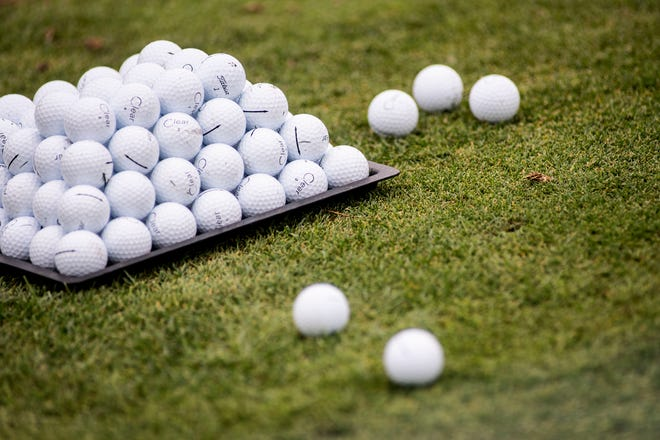 Golf balls on the driving range at Battle Creek Country Club.