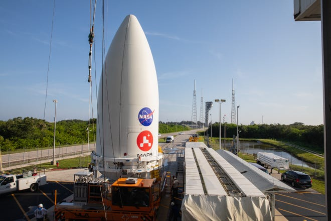 The payload fairing, or nose cone, containing the Mars 2020 Perseverance rover sits atop the motorized payload transporter that will carry it to Space Launch Complex 41 on Cape Canaveral Air Force Station in Florida. The image was taken on July 7, 2020.