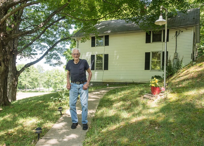 Robert Parker stands in front of his Chillicothe home that he was born in on July 20, 2020. Parker will turn 100 years old on Saturday, July 25.