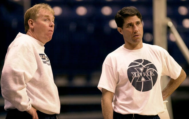 Oct. 19, 2000: Xavier University's head basketball coach Skip Prosser, left, and assistant men's basketball coach Dino Gaudio talk during a team practice.