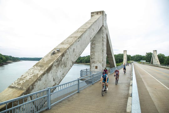 Riding along the Mehaffey Bridge bike trial over the Iowa River while riding with members of eastern Iowa RAGBRAI groups, Tuesday, July 21, 2020, in Johnson County, Iowa.