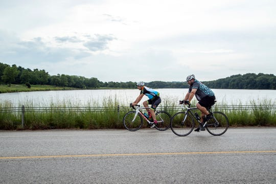 RAGBRAI Director Dieter Drake, left, rides through Lake Macbride State Park, Tuesday, July 21, 2020, in Solon, Iowa.