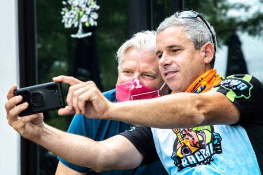RAGBRAI Director Dieter Drake, right, takes a photo with Doug Goettsch of Big Grove Brewery while visiting with members of eastern Iowa RAGBRAI groups, Tuesday, July 21, 2020, in Solon, Iowa.