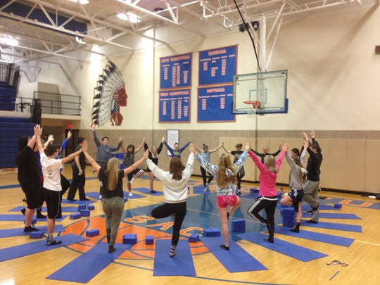 An Indian head mascot mural is seen in the school gym in Saugatuck.