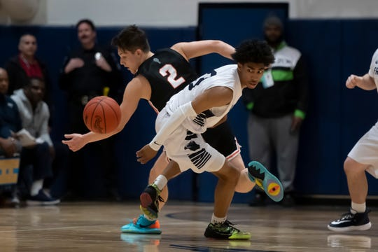 Point guard Jaden Akins (foreground) has Michigan State and Michigan in his top six schools, he revealed on Twitter.