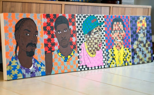Artist Denzel Palm's portraits are often painted over jigsaw-puzzle backgrounds.