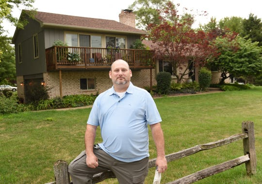 Mike Mcdevitt stands in front of his new West Bloomfield home, Tuesday, July 21, 2020.