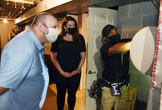 Inspector Charles Shaver, right, of CNM Inspection Services inspects the humidifier as new home owner Mike Mcdevitt and real estate agent Christina Gennari watch, Tuesday, July 21, 2020.
