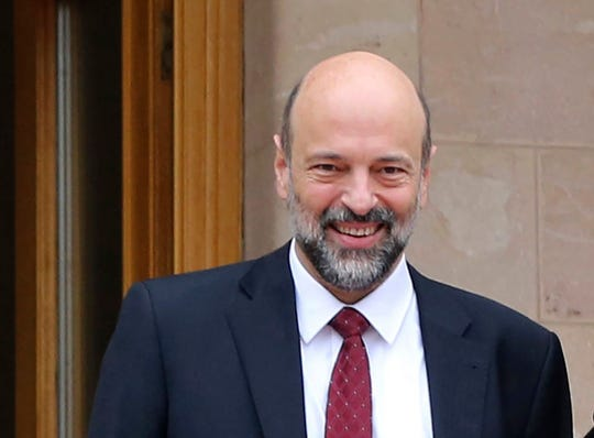 This Jan. 15, 2017 file photo, shows then newly appointed Education Minister Omar Razzaz, following a meeting at the Royal Palace, in Amman, Jordan.
