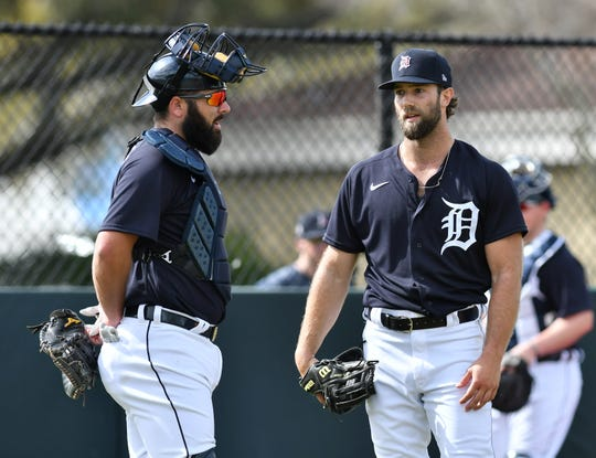 Tigers pitcher Daniel Norris (right) has been cleared to return to the team after testing positive for COVID-19.