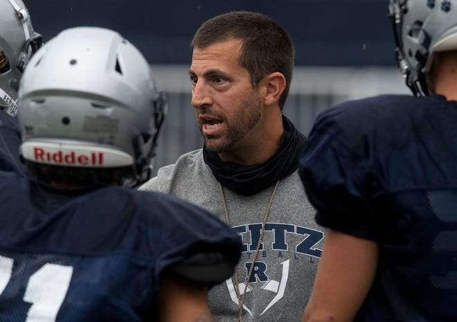New Reitz head coach Cory Brunson calls a play during practice at the Bowl on Monday night.