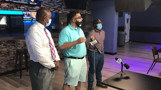 Bruce Wilson, left, Christopher Johnson, and Travis Green hold a press conference at Dolce on White Horse Road to address Greenville County's effort to revoke the restaurant's business license following shootings over July Fourth weekend.
