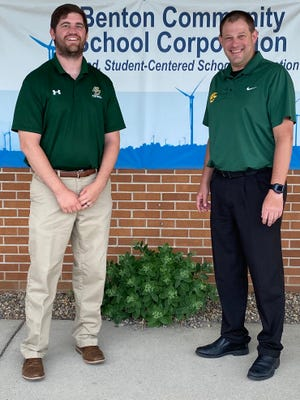 Tyler Marsh, left, stands with Benton Central athletic director Dan Meyer after being approved as the new football coach at Monday's board meeting.