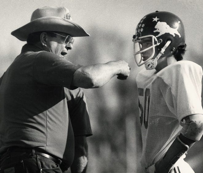 St. Pius football coach Joe Maupin, left, gives instructions to Bill Stivers during the 1981 Toy Bowl.