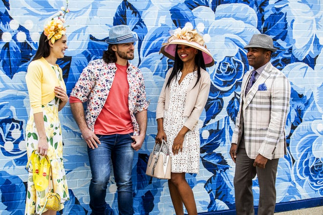 Models Kristina Russ, Josh Frank, Kasi Shelton and Derrick Clarkson relaxed during a Kentucky Derby fashion shoot with stylist Jo Ross at Churchill Downs. March 11, 2020  All merchandise from Von Maur, Oxmoor Center, Louisville, Ky., during a Kentucky Derby fashion shoot with stylist Jo Ross at Churchill Downs. Models from Cosmo Model and Talent Agency.