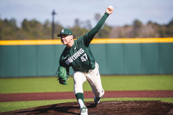 Michigan State's Jesse Heikkinen delivers a pitch during a game.