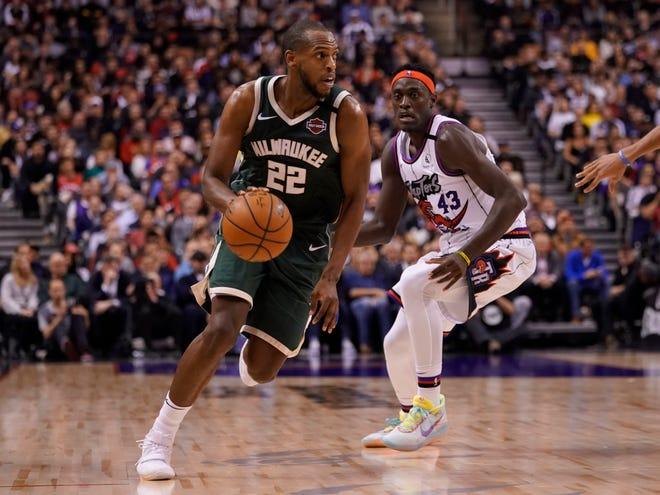 Khris Middleton and the Bucks face the Toronto Raptors Monday night.