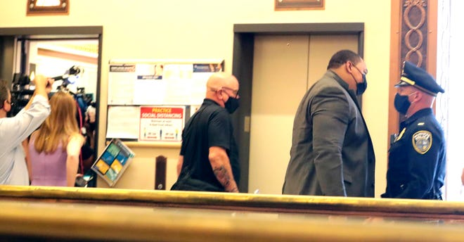 Fire and Police Commission Chairman Steven DeVougas and Commissioner Raymond Robakowski quietly exit a meeting with Milwaukee Police Chief Alfonso Morales and his attorney Frank Gimbel Monday, July 20, 2020.