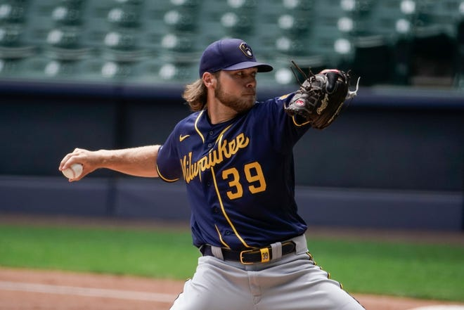 Milwaukee Brewers' Corbin Burnes throws during an intrasquad baseball game, Monday, July 20, 2020, at Miller Park in Milwaukee. (AP Photo/Morry Gash) ORG XMIT: WIMG122