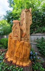 After a 200-year-old oak tree died in the backyard of Ann and Morgan White's home in Whitefish Bay, they hired an artist to carve a sculpture from it.