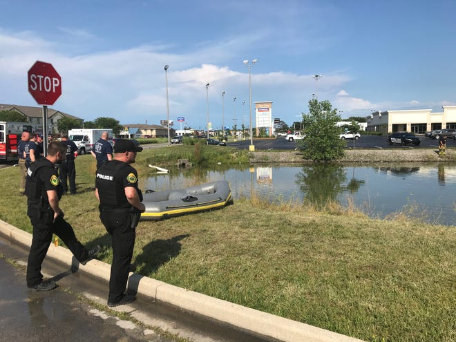 A man was taken by ambulance to IU Health Ball Memorial Hospital late Tuesday afternoon after his car went into a retention pond in northwest Muncie and sank.
