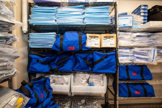 Protective gowns, masks and other personal protective equipment is stacked in the storeroom at Newark Beth Israel Medical Center, part of RWJBarnabas Health, in preparation for use with COVID-19 patients.