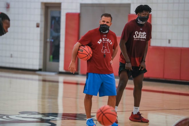 New Mexico State head coach Chris Jans calls out drills with forward Donnie Tillman at a pre-season practice for the NMSU men's basketball team in Las Cruces on Tuesday, July 21, 2020.