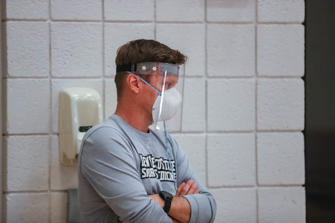 Members of the New Mexico State athletic staff wear masks and face shields at a pre-season practice for the NMSU men's basketball team in Las Cruces on Tuesday, July 21, 2020.