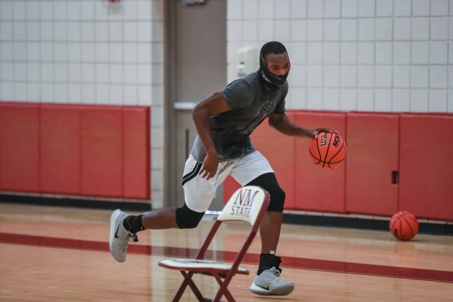 New Mexico State guard Marcus Watson runs drills at a pre-season practice for the NMSU men's basketball team in Las Cruces on Tuesday, July 21, 2020.