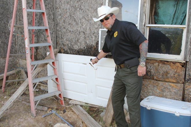 Eddy County Sheriff Mark Cage points out a hidden camera during a June 12, 2020 drug bust in Carlsbad.