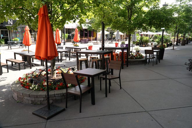 Tables line the sidewalk and road of Main Street in downtown Northville on July 21, 2020. The city is considering enacting an ordinance to allow patrons to transport drinks around the downtown area.