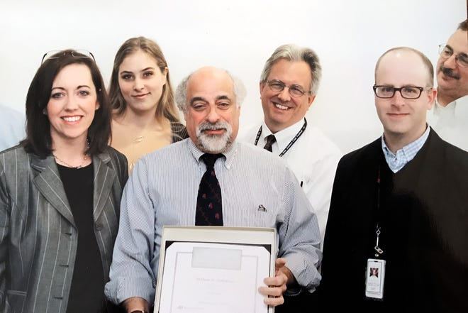 This 2009 photo shows Arthur H. Rotstein (center), then the Tucson correspondent for The Associated Press, during a 2009 celebration marking his 35 anniversary with the news agency. Rotstein, who retired in 2010, died on Monday, July 20, 2020, from COVID-19. Also shown (from left) are Michelle Williams, then chief of bureau in Arizona; AP journalists Amanda Lee Myers, Paul Davenport, Jacques Billeaud, and Bob Christie.
