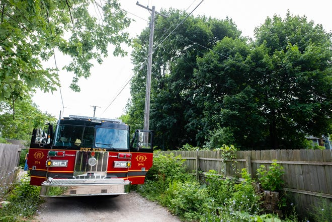 Crews rescued a man from a tree between Ninth and 10th streets and Union and Court streets Tuesday, July 21, 2020, in Port Huron. The man became stuck approximately 30 feet in the tree after attempting to retrieve a crashed drone.